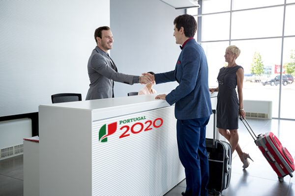 Man and receptionist handshake at reception hall